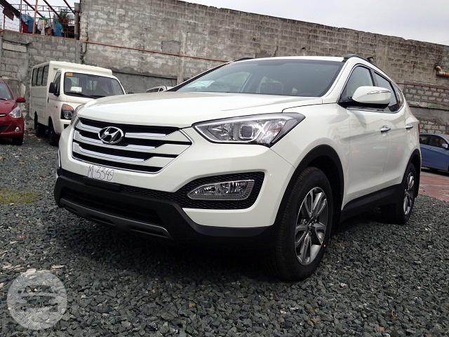 2016 Hyundai Santa Fe (White) Sedan  / Makati, Metro Manila   / Hourly ₱0.00